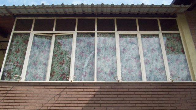 Trasformare un balcone o un terrazzino in veranda? Serve il permesso di costruire
