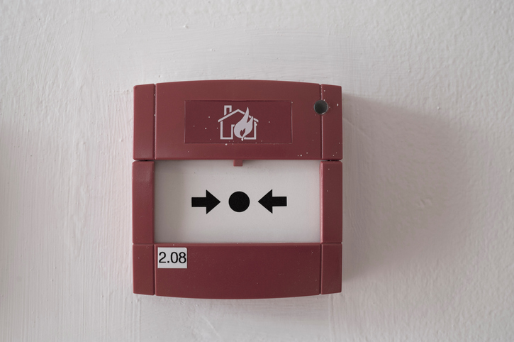 fire alarm box on cement wall for warning