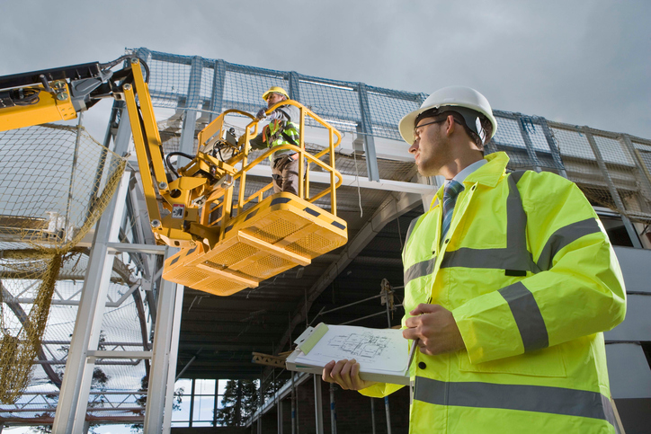 Construction workers with crane